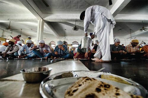People Eating Langar in Gurudwara